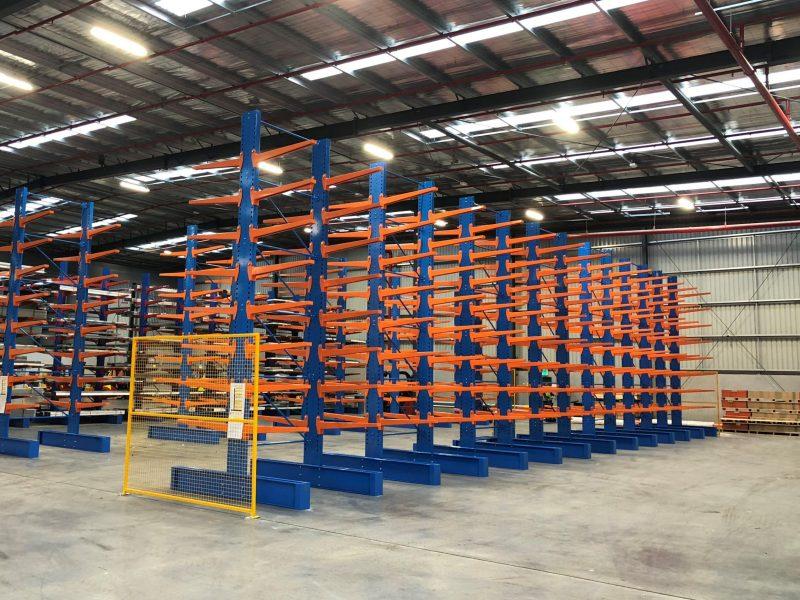 Blue and organge cantilver racking inside a huge warehouse